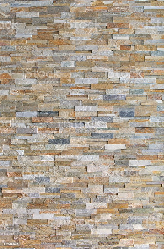 Stacked brick in neutral tones wall stock photo