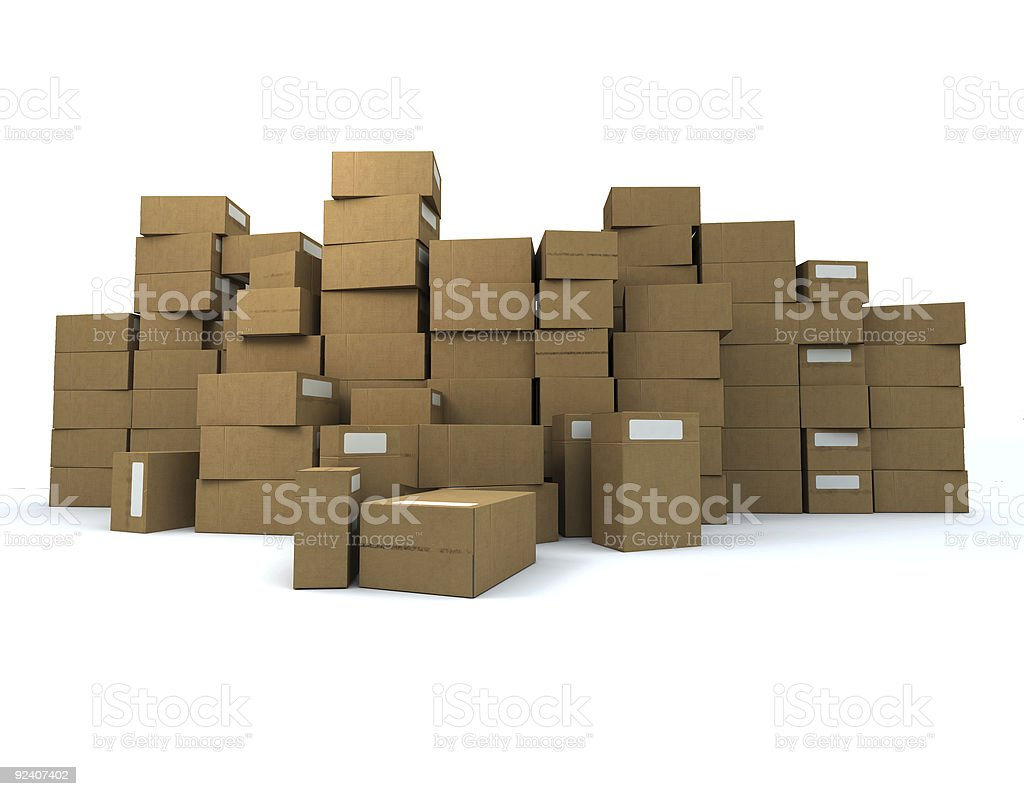 Stacked cardboard boxes in a white storage room royalty-free stock photo