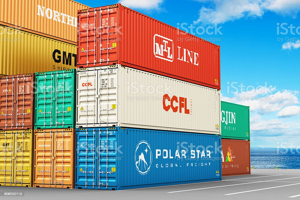 Stacked cargo containers in freight sea port terminal stock photo