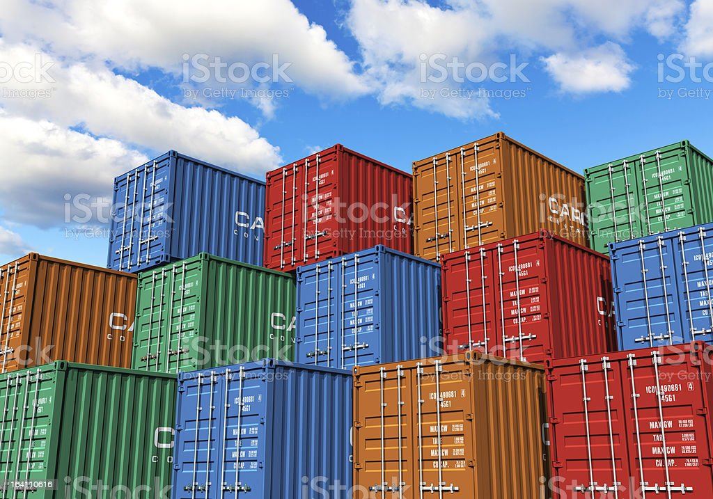 Stacked cargo containers in port stock photo