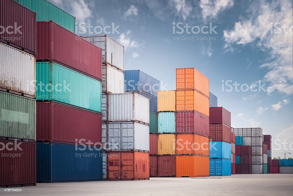 stacked cargo containers stock photo