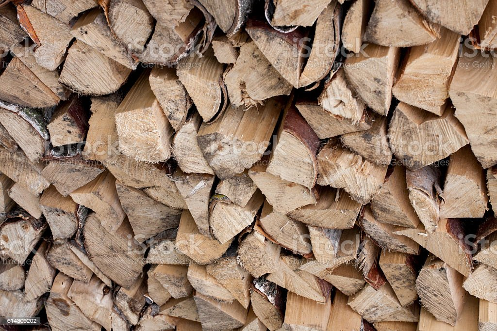 Stacked chopped firewood as background stock photo