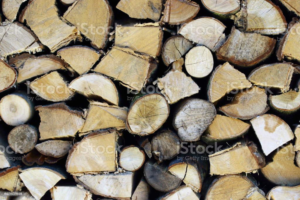 Stacked cleaved wood stock photo