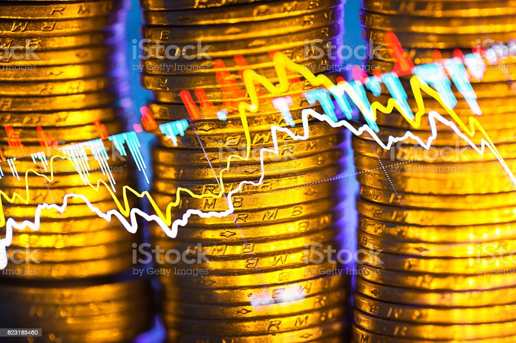 stacked coin illuminated with golden light stock photo