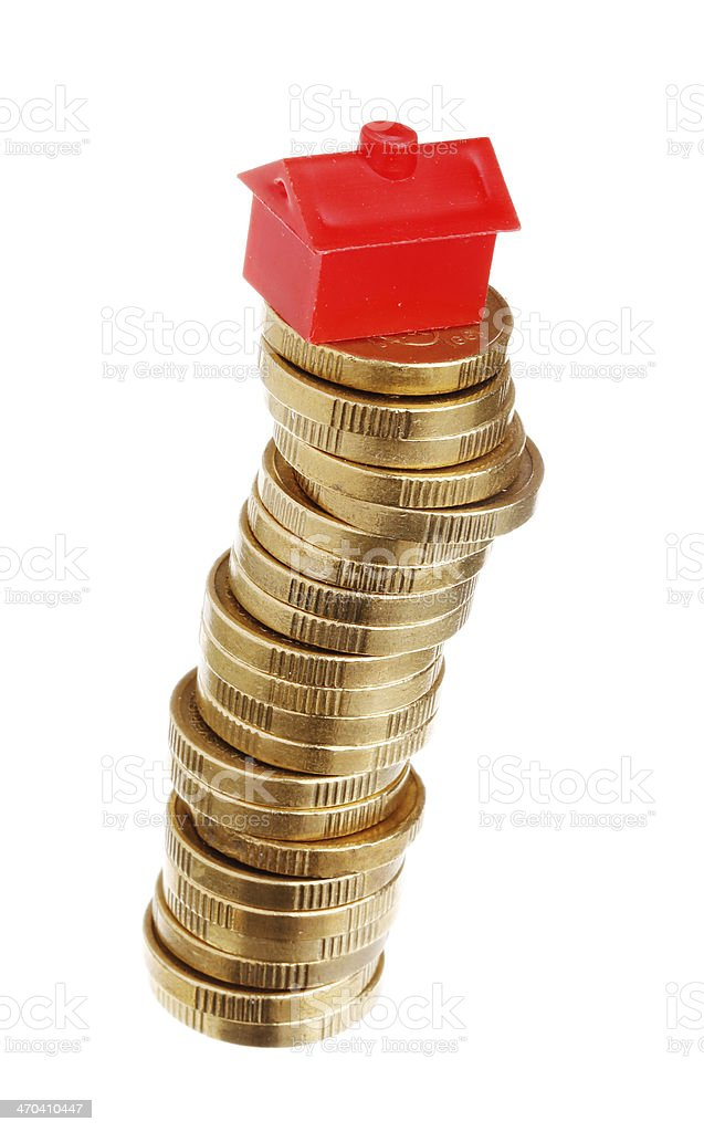 Stacked coins vith red house royalty-free stock photo