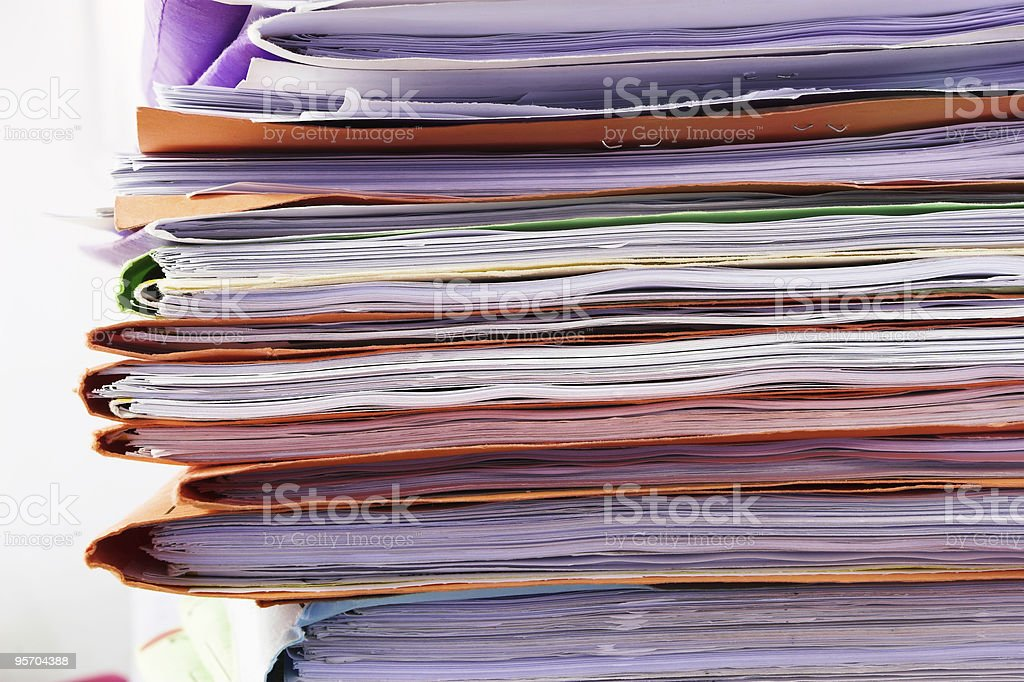 Stacked colourful files stock photo