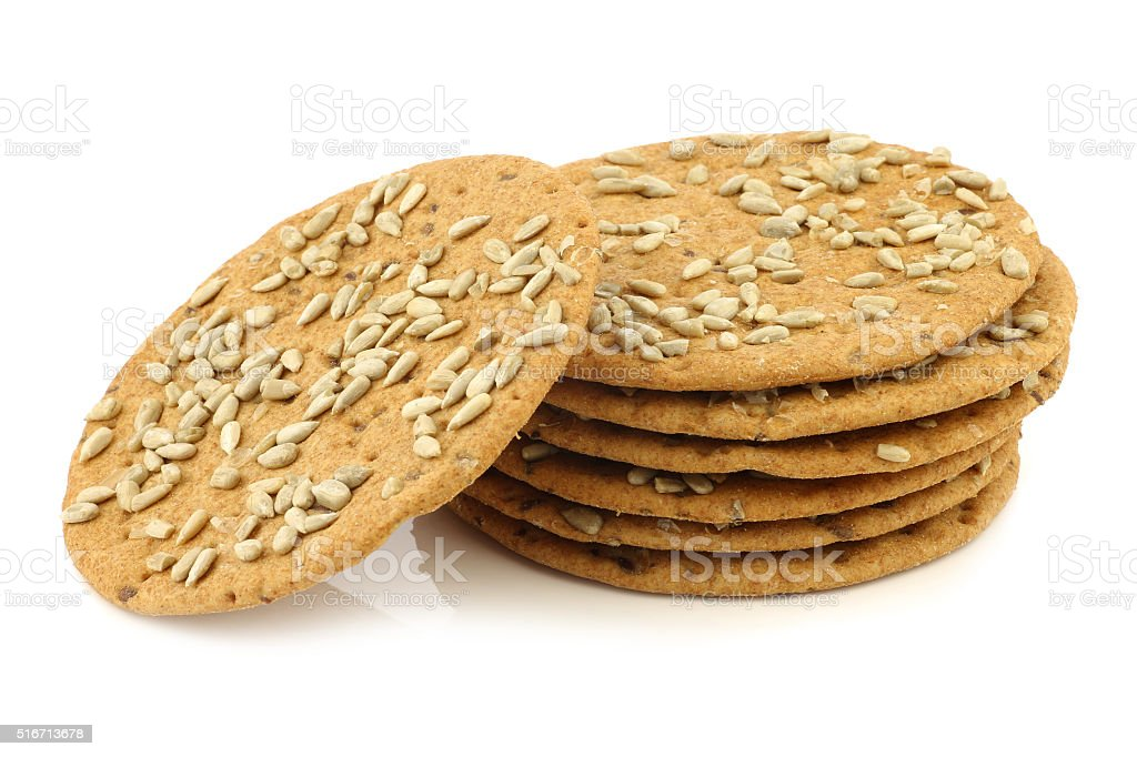 stacked crispy spelt crackers with sunflower seeds stock photo