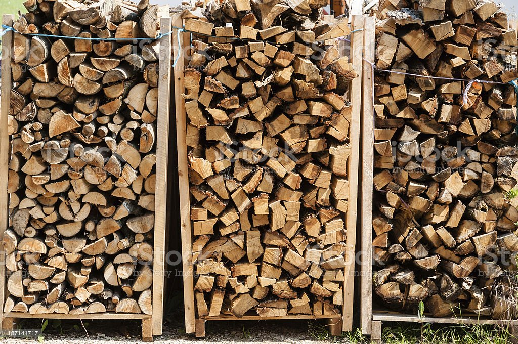 Stacked firewood, format filling as wallpaper stock photo