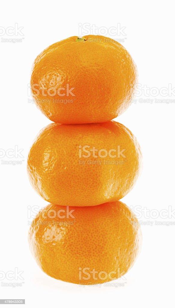 Stacked fresh mandarin isolated on white background. royalty-free stock photo