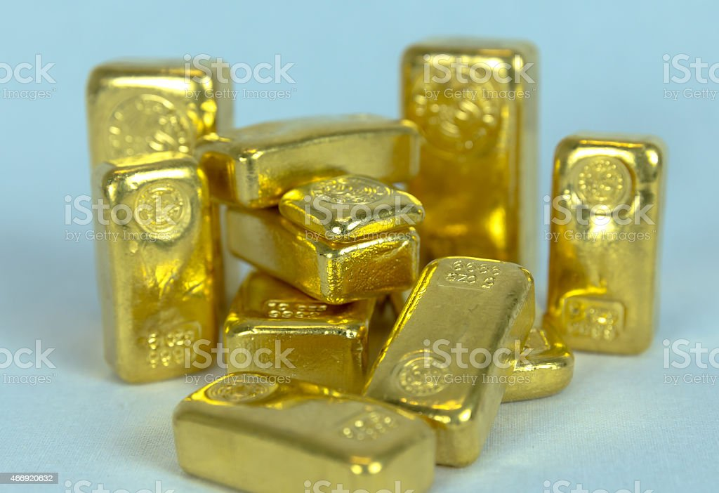 Stacked Gold Bars of various sizes. stock photo
