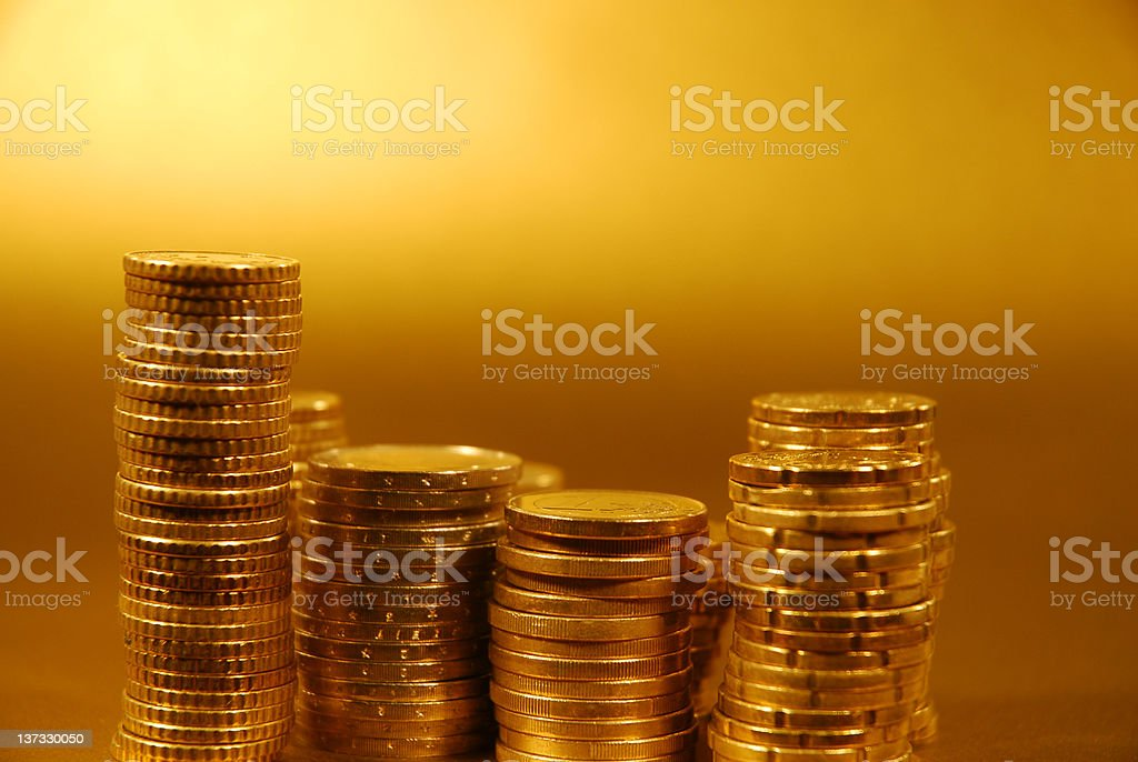 Stacked gold coins stock photo