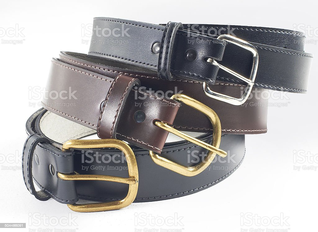 Stacked leather belts stock photo