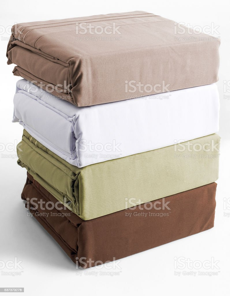 stacked linen bed sheets stock photo
