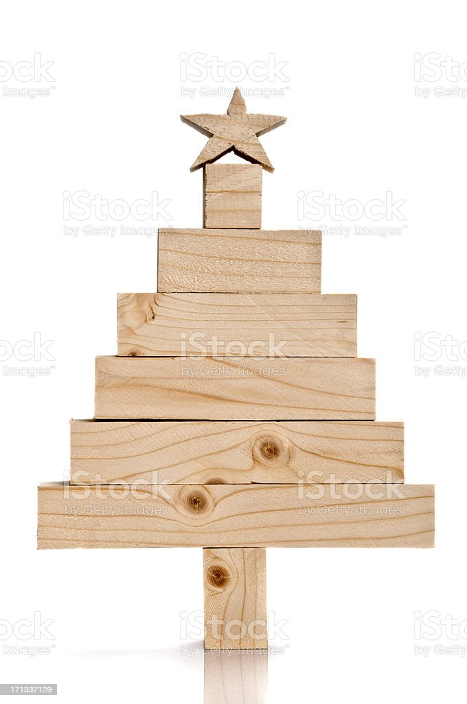 Stacked lumbers in the shape of a christmas tree stock photo