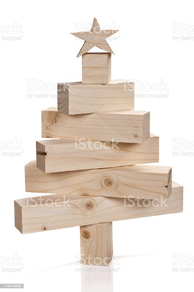 Stacked lumbers in the shape of a christmas tree royalty-free stock photo