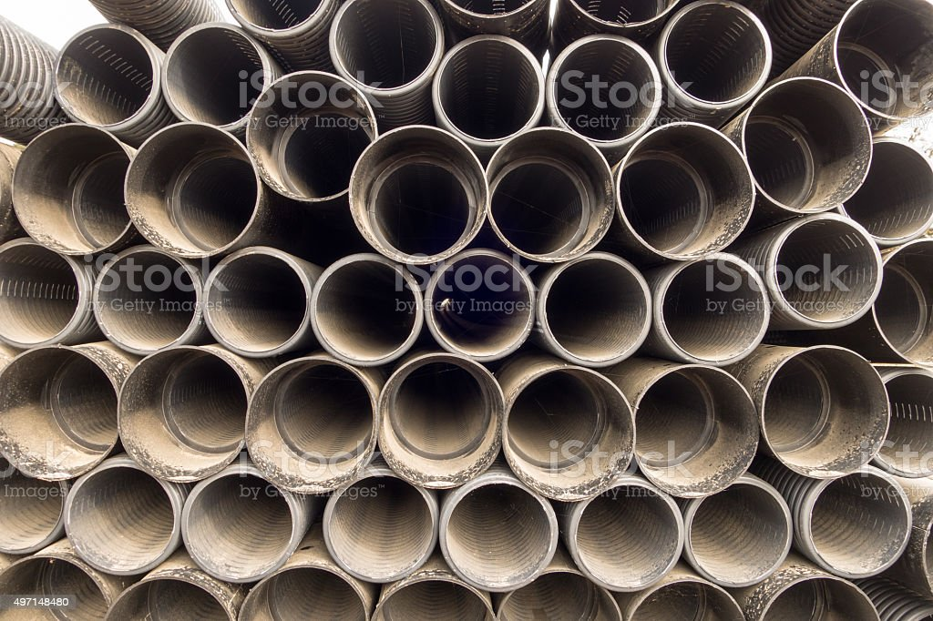 Stacked new PVC pipe on construction site stock photo