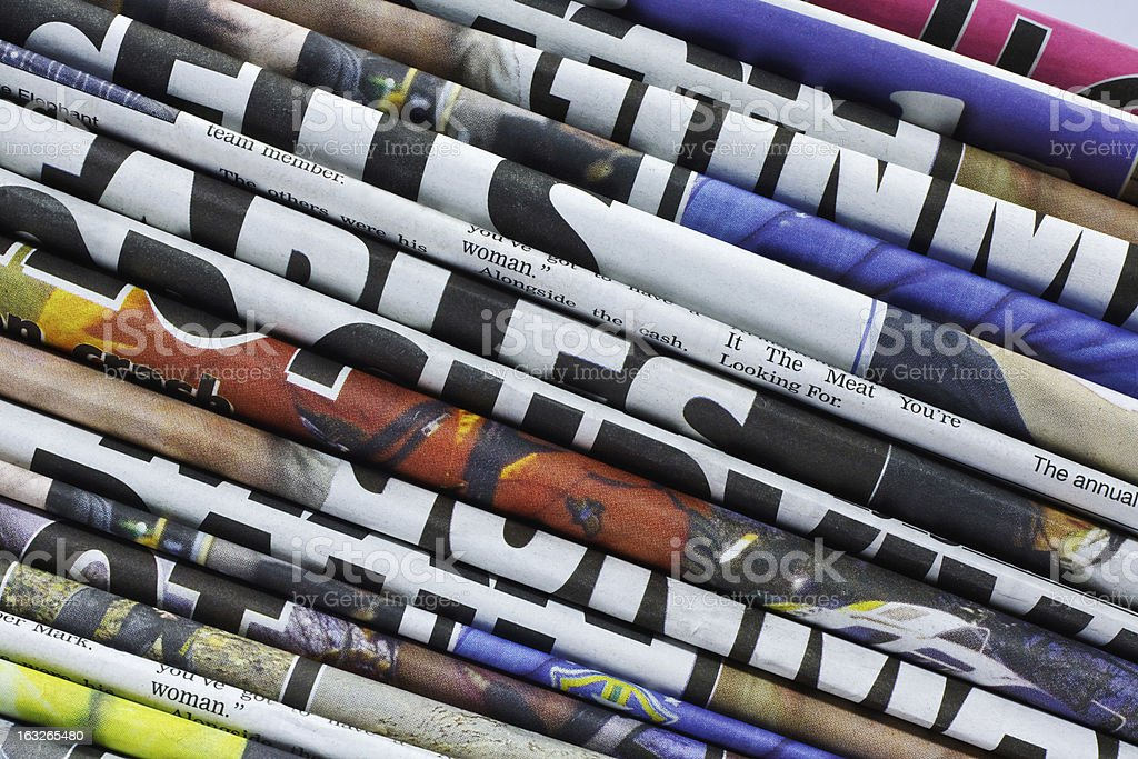 stacked newspapers or journals royalty-free stock photo