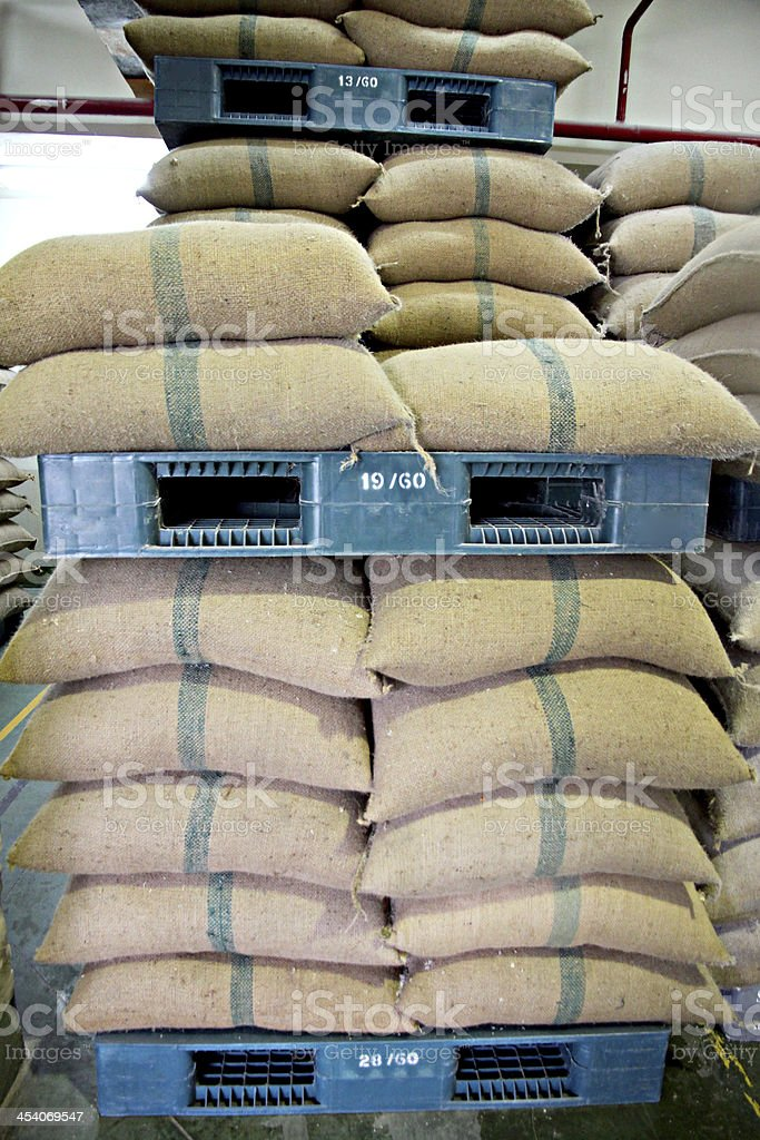 Stacked of Rice sacks in warehouse. stock photo