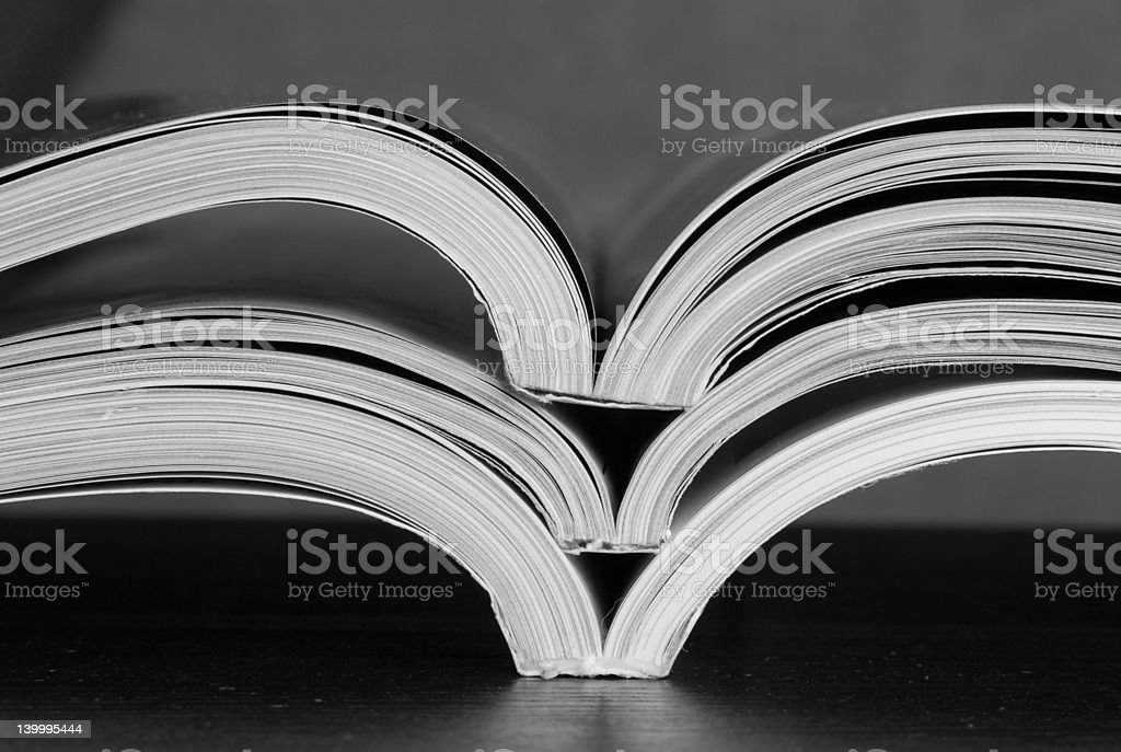 stacked open magazines royalty-free stock photo