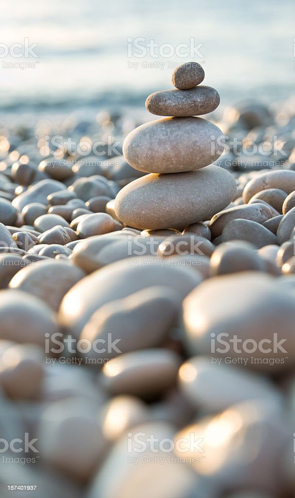 Stacked pebbles on a beach royalty-free stock photo