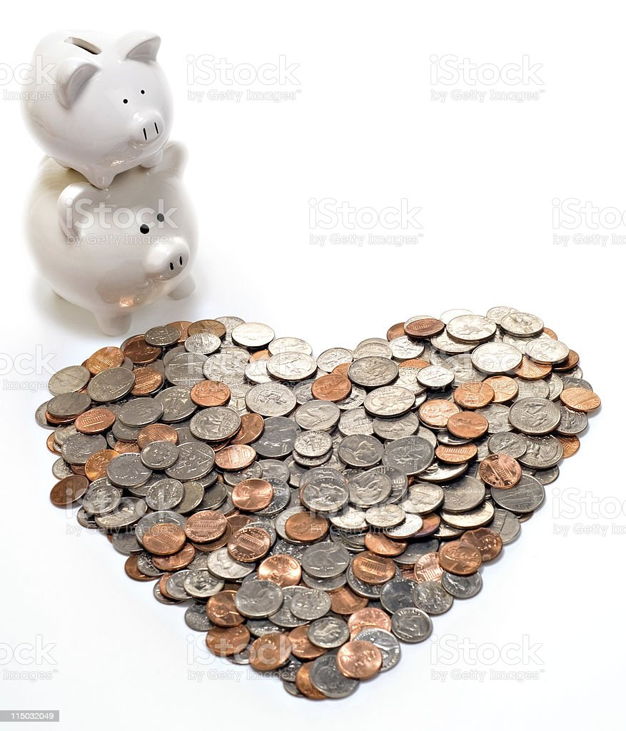 Stacked Piggy Banks Looking Over Coin-Filled Heart stock photo