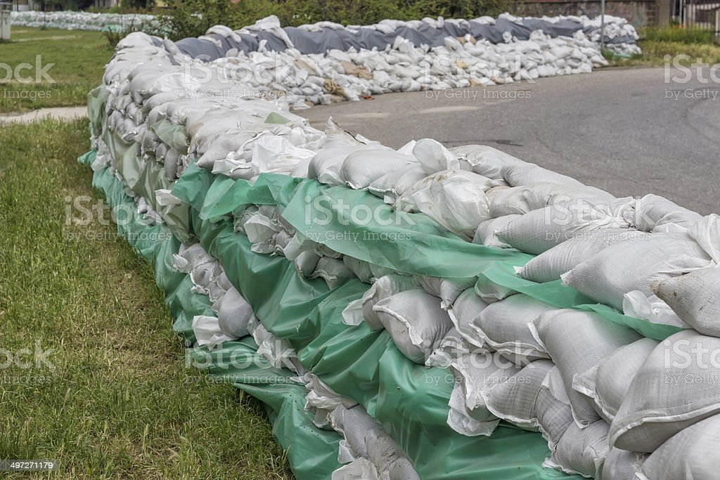 stacked pile of sandbags for flood defense 2 royalty-free stock photo