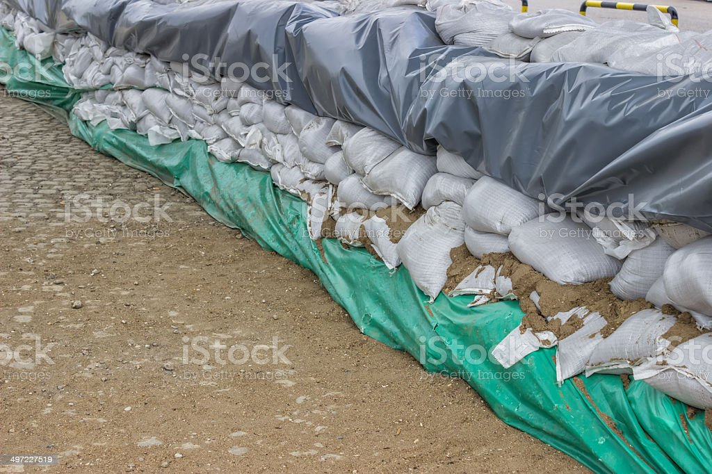 stacked pile of sandbags for flood defense royalty-free stock photo