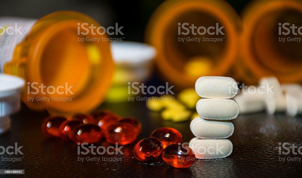 Stacked Pills Softgels Open Bottles Blurred Background Medicine stock photo