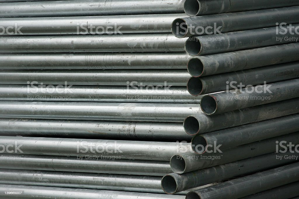 Stacked pipes stock photo