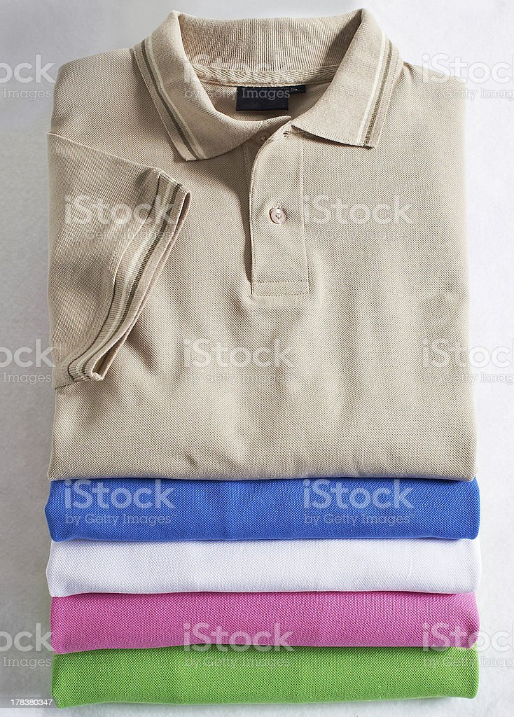 stacked polo shirts stock photo