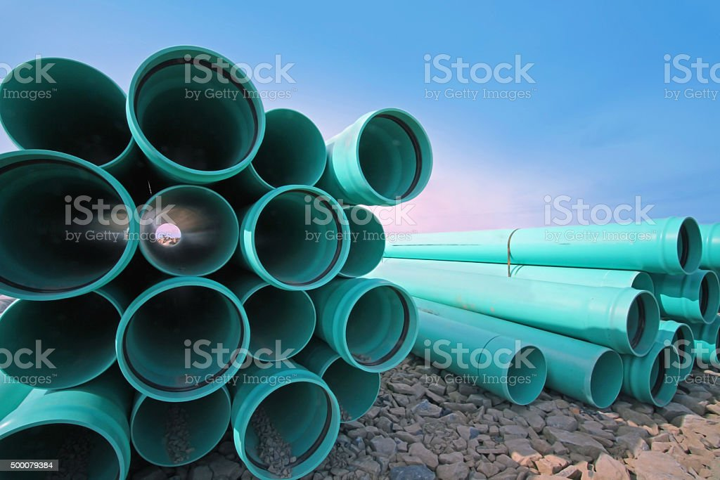Stacked PVC Water Pipe On A New Road Construction Site stock photo
