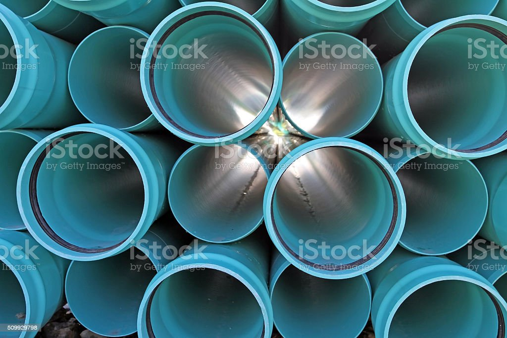 Stacked PVC Water Pipe On Construction Site, End View stock photo