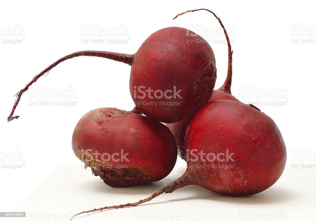 Stacked red beets against white background royalty-free stock photo
