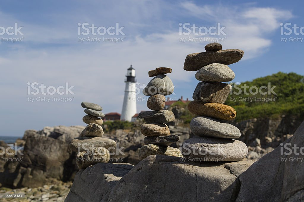 Stacked Rocks in front of Portland Head Light stock photo