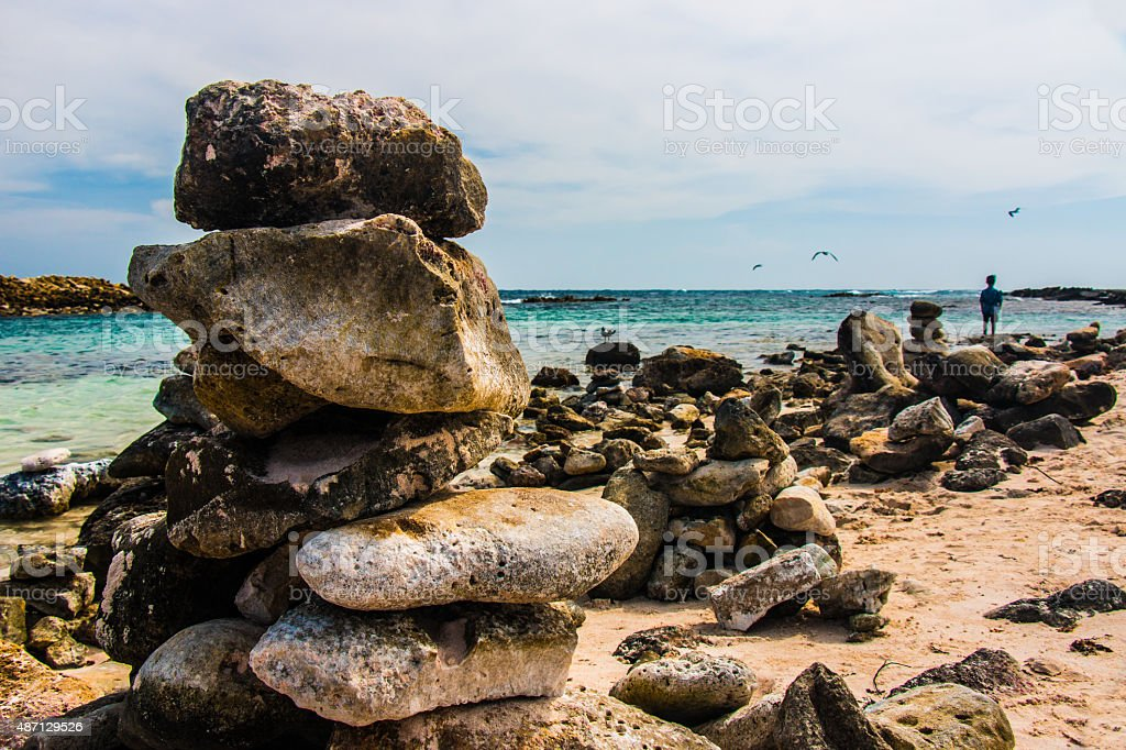 Stacked rocks with boy stock photo