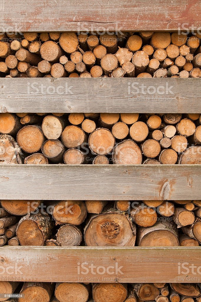 Stacked sewed tree branches stock photo