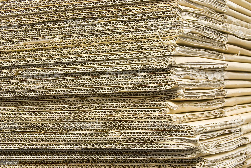 Stacked sheets of corrugated cardboard royalty-free stock photo