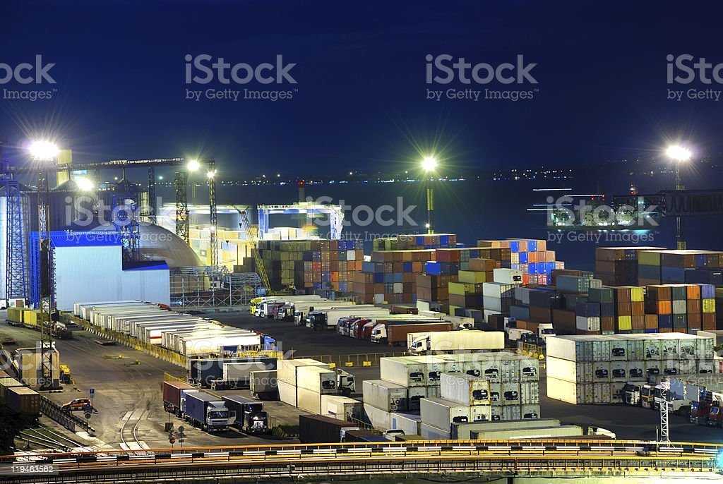 Stacked shipping containers in a port royalty-free stock photo