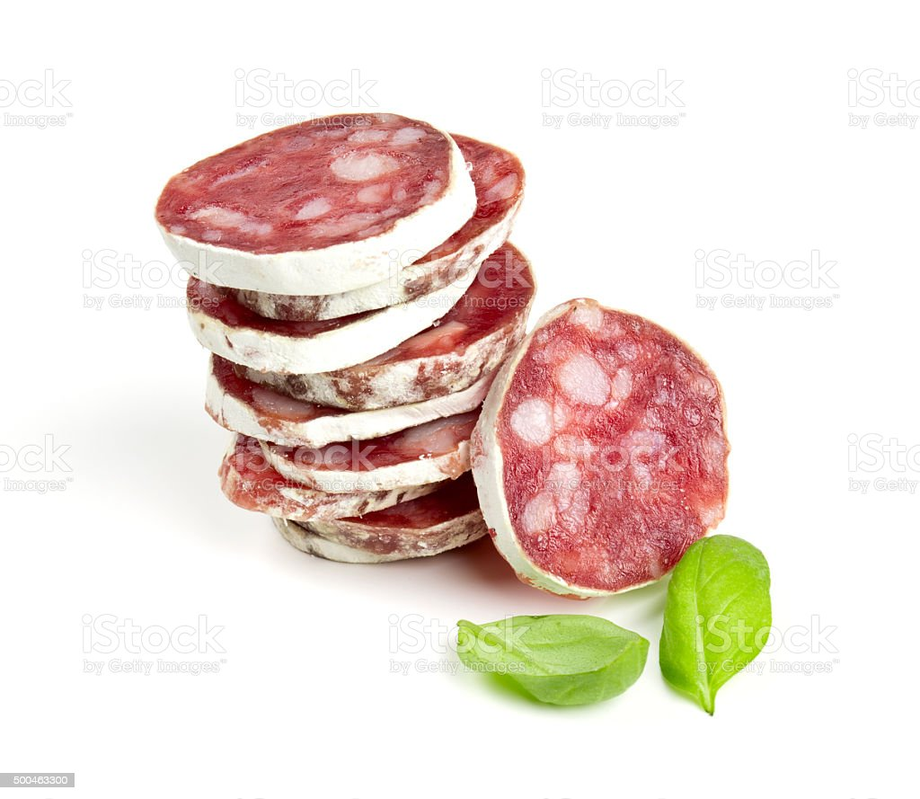 stacked sliced salami isolated on white stock photo
