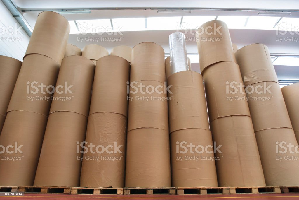 Stacked spools of paper in warehouse of printing company royalty-free stock photo