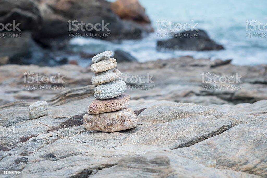 Stacked stone, rock stacking near sea shore, Thailand traveling stock photo