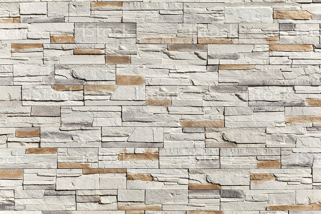 Stacked Stone wall as a background and texture royalty-free stock photo