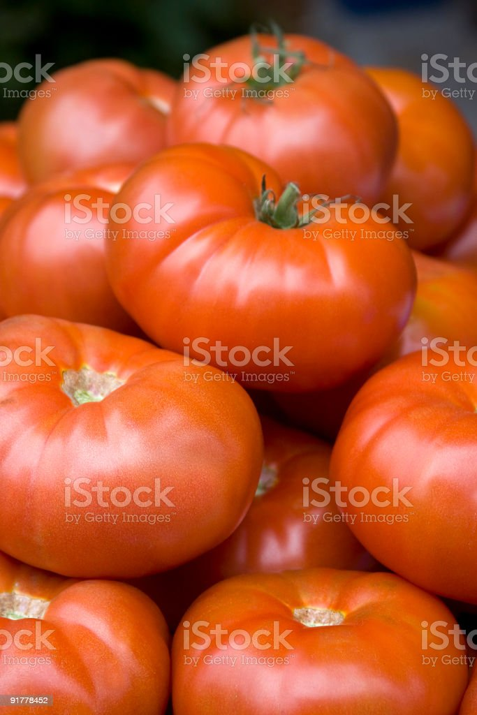 Stacked tomatoes stock photo
