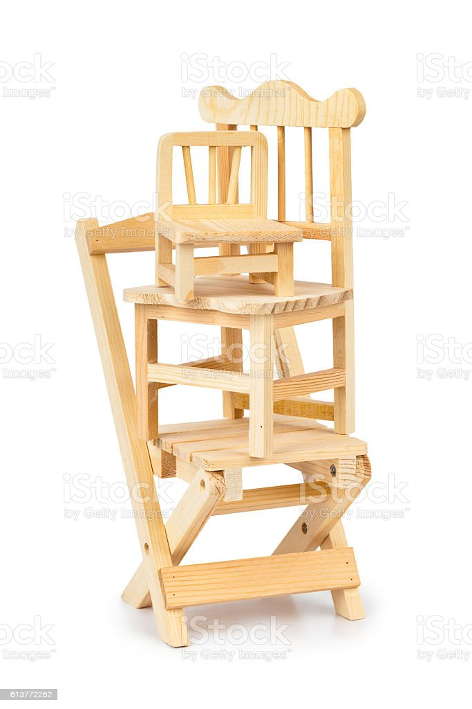 Stacked toy wooden chairs stock photo