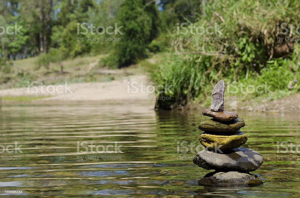 Stacked up balanced rocks in river royalty-free stock photo