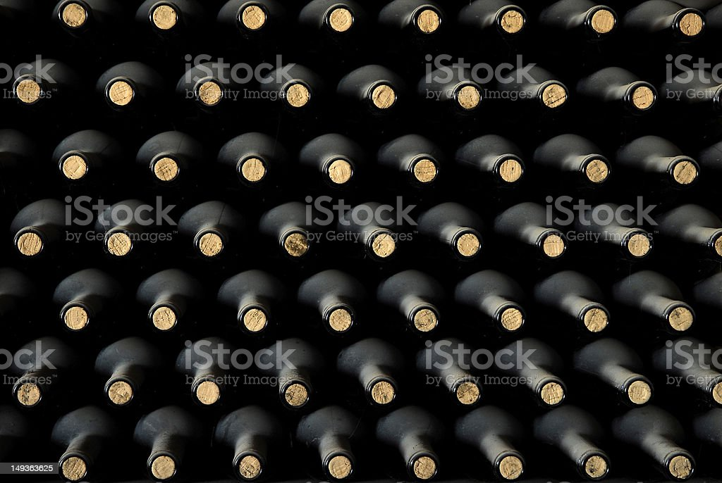 Stacked up wine bottles in the cellar royalty-free stock photo