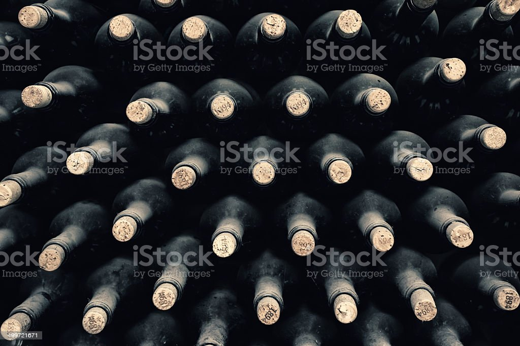 Stacked up wine bottles stock photo
