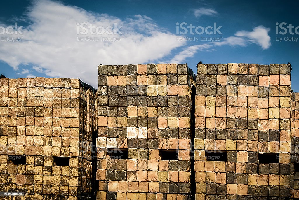 Stacked Weathered Rustic Construction Bricks, Blue Sky XXXL stock photo