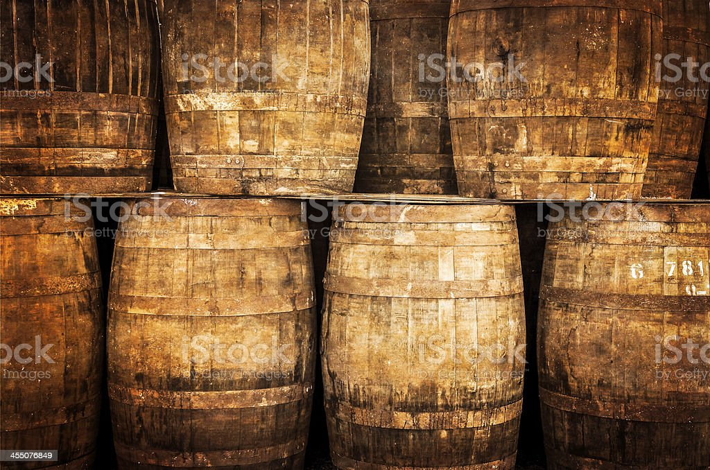 Stacked whisky and wine barrels in vintage style stock photo