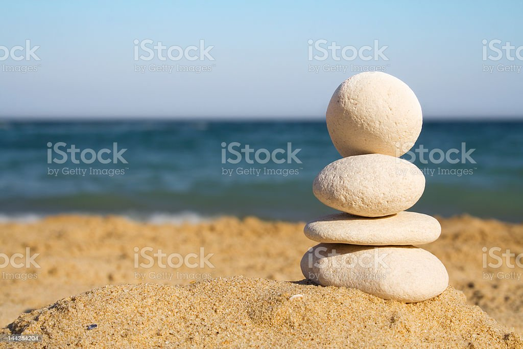 Stacked white pebbles on the beach royalty-free stock photo